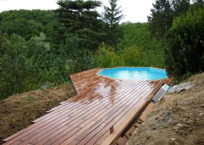 Piscine hors sol avec terrasse en bois exotique à Charbonnières les Bains 69260